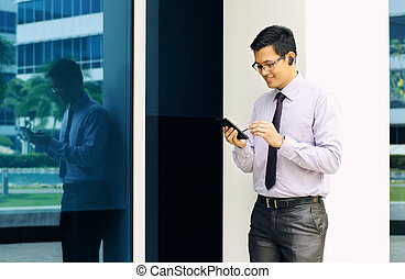 Businessman Writing With Pen On Mobile Phone Display-2 -...
