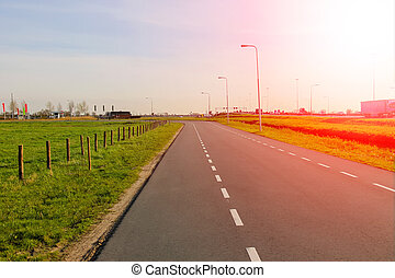 The road in the Netherlands at sunset