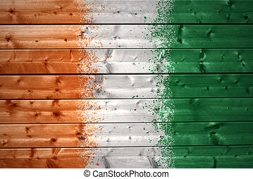painted ivorian flag on a wooden texture - colorful painted...