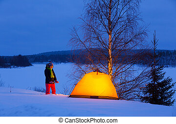 Woman in winter camping - Woman camping in the snow covered...