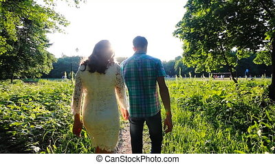 Young couple in love walking glide shot