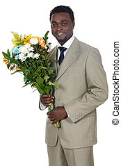Man with flowers - Attractive black man with bunch of...