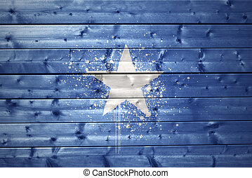 painted somalia flag on a wooden texture - colorful painted...
