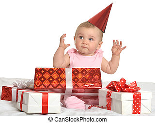 Baby girl sitting with gifts - Portrait of Cute baby girl...