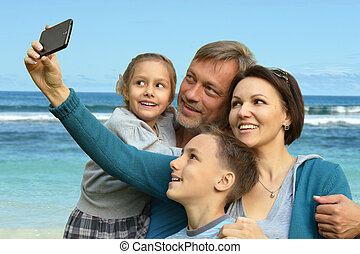 friendly family on a background of a seashore