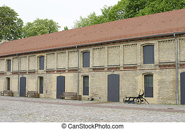 Horse farm - The exterior facade of the stables of a Horse...