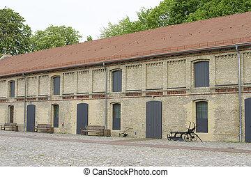 Horse farm - The exterior facade of the stables of a Horse...