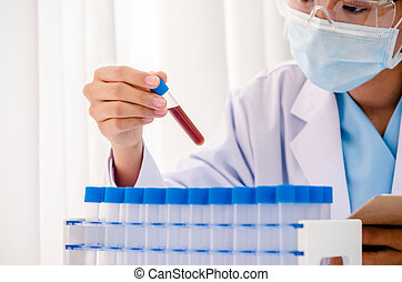 scientist in research lab - close up of scientist examining...