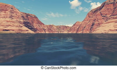 Follow on the river among red rocks - River level view from...