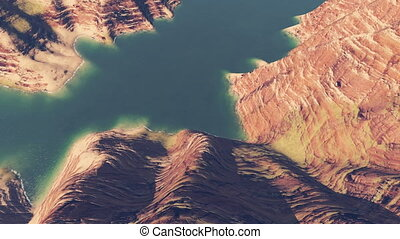 River in the bottom of deep canyon - Downward movement to...