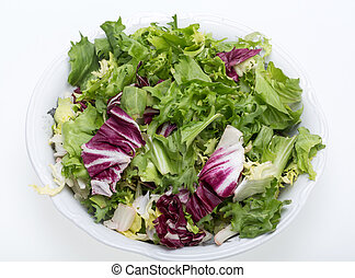 Green and red leaf of lettuce Isolated on a white background...