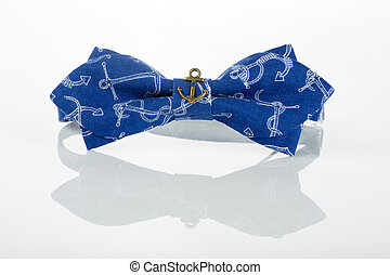 blue bow tie with anchors on a white background with...