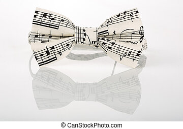 white bow tie with notes on a white background with...