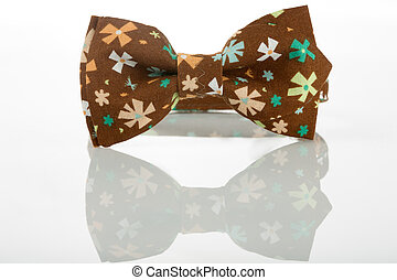 Brown bow tie on a white background floret - Brown bow tie...