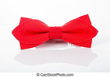 Red bow tie on a white background with reflection