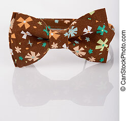 Brown bow tie on a white background. floret - Brown bow tie...