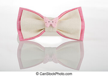 white bow tie with pink accents and a butterfly on a white...