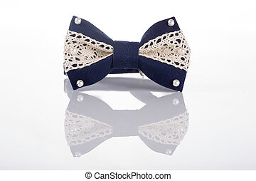 blue bow tie with white lace on a white background with...