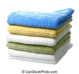 colorful towels - stack of colorful towels isolated on white...