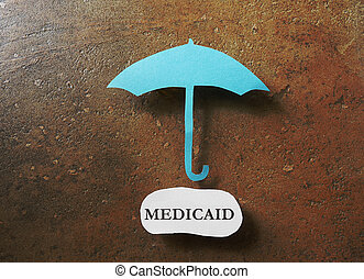 medicaid protection - Paper umbrella over a Medicaid message...