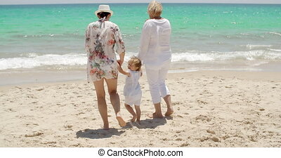 Grandmother mother and baby girl at the seaside - Three...