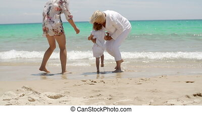 Loving grandmother playing with her grandchild on a sunny...