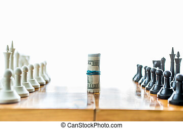 twisted money on board between rows of chess pieces -...