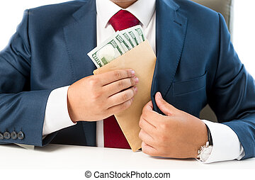 conceptual photo of bribed man putting money in the suit...