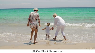 Grandmom Mom and Little Girl Playing at the Beach - Little...