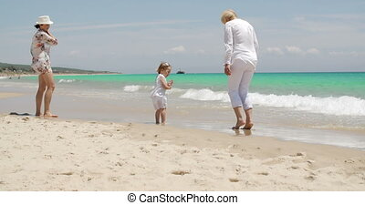 Grandma Mom and Girl on Summer Beach Holiday - Grandma Mom...