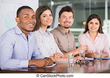 Business - Successful business people sitting at conference...