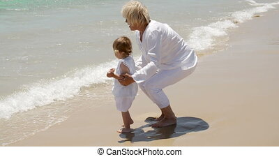 Grandma and Little Girl Having Fun at the Beach - Blond...