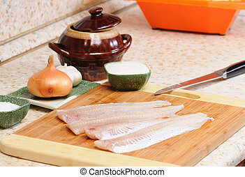 Meal preparation on kitchen from a fish