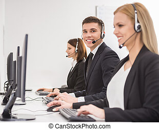 Call center - Side view of a group of business colleagues...