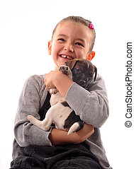 child and puppy - laughing little girl and her purebred...