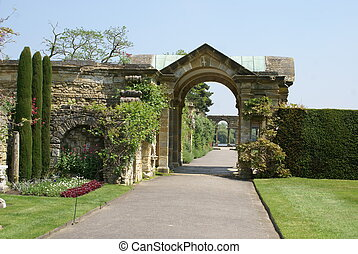 archway, Hever Castle Garden, UK - archway at a lakeside in...