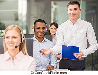 Call center - Manager explaining something to his employee...