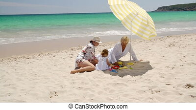 Family Having Great Time on The Beach With Playing Plastic...