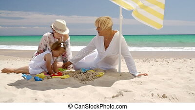 Grandma Mom and Little Girl Playing at Beach Sand - Grandma...