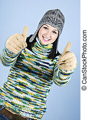 Successful girl in wool sweater give thumbs - Successful...