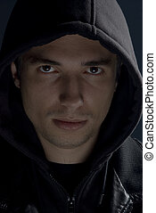 Young man with hood - Young man in black hood and jacket in...