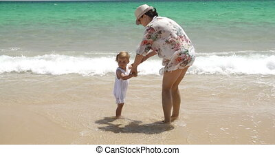 Mom and Daughter Bonding at the Beach on Summer