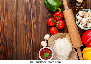Pizza cooking ingredients Dough, vegetables and spices Top...
