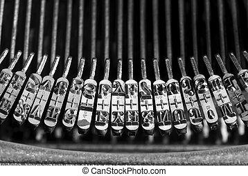 Typebar on vintage typewriter