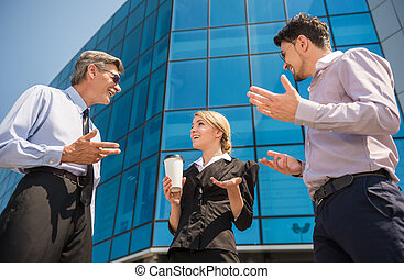 Business outdoor - Confident business people discussing...