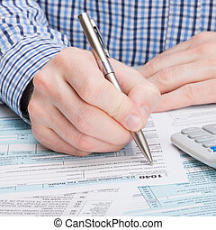 Taxpayer filling out 1040 Tax Form