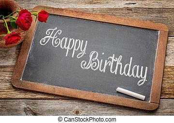 Happy Birthday greetings on blackboard