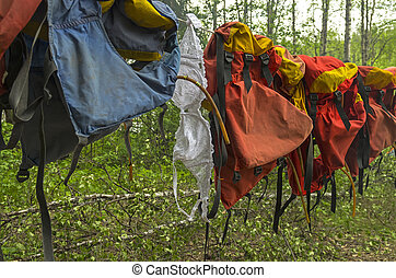 Lingerie drying on a clothesline with lifejackets. -...
