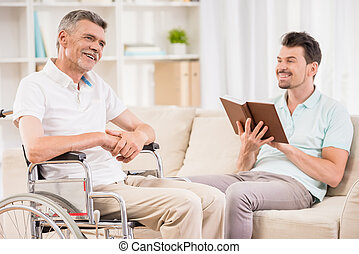 Old man at hospital - Adult man sitting at home and reading...