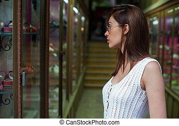Young woman looking at the shop window